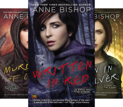 Covers of the Others series by Anne Bishop all featuring a darkhaired woman with red streaks in her hair.