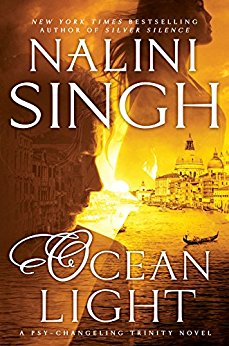 Yellow backlight cover of NaliniSingh's Ocean Light a man and a woman in profile  superimposed on the skyline of venice_
